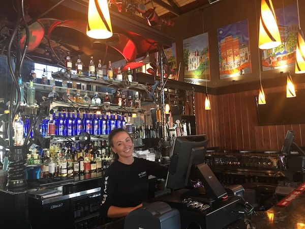 Bartender using NCR aloha at the White Rose Bar and Grill