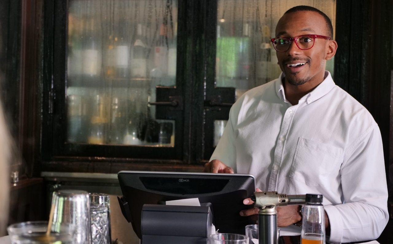 Man using aloha point of sale at bar