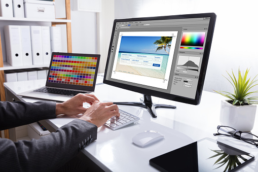 Close-up Of A Designer's Hand Editing Photo On Computer In Office