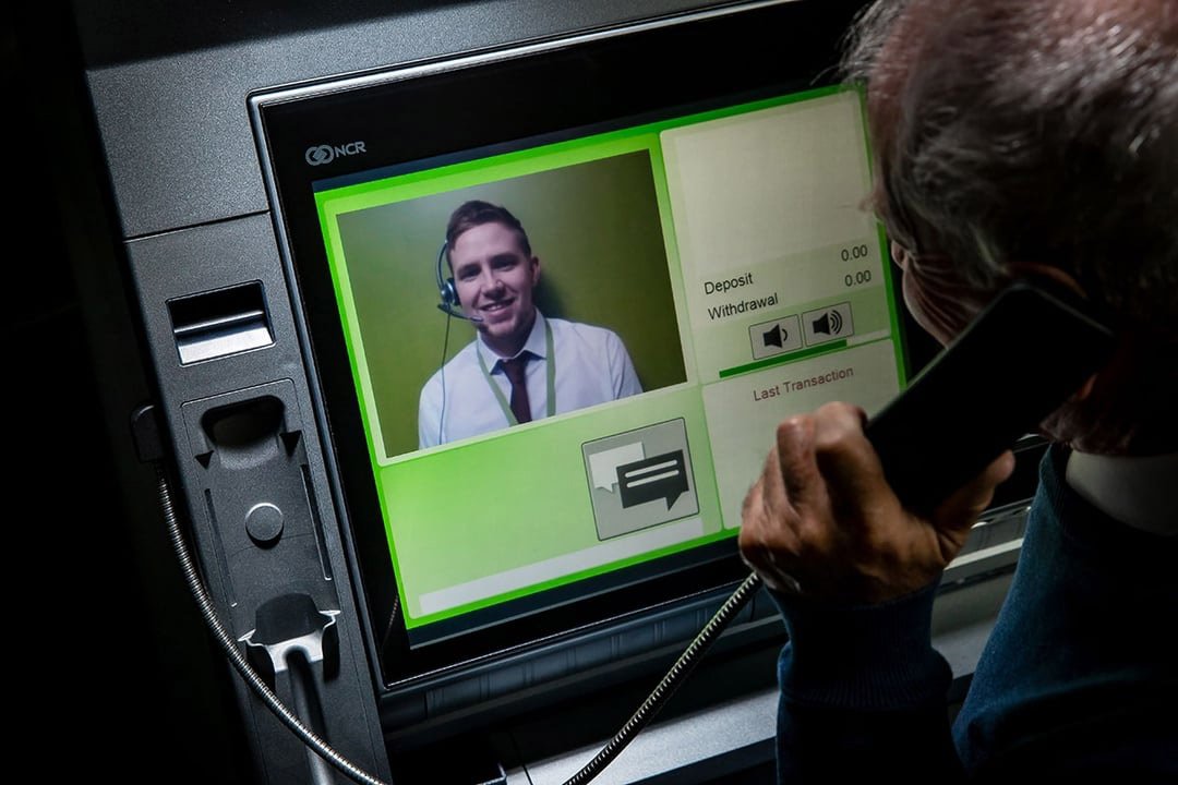 Man using interactive teller