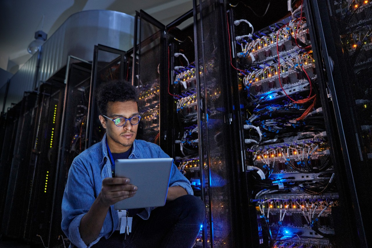 male man technician working on tablet for services on technology and data