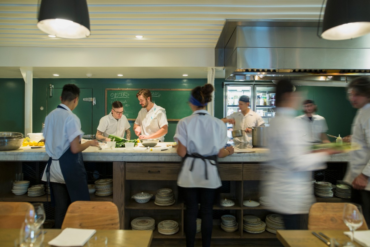 busy kitchen management of chefs and waiters