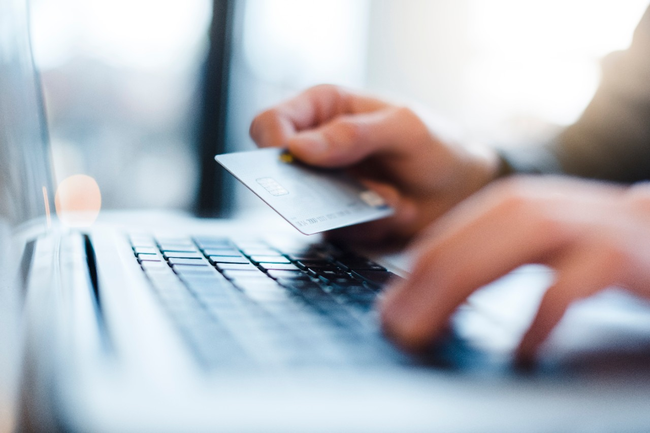 Using laptop and credit card for digital online purchasing