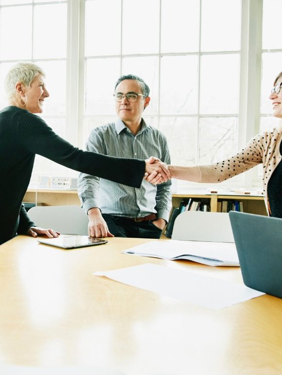 Clients shake hands with broker