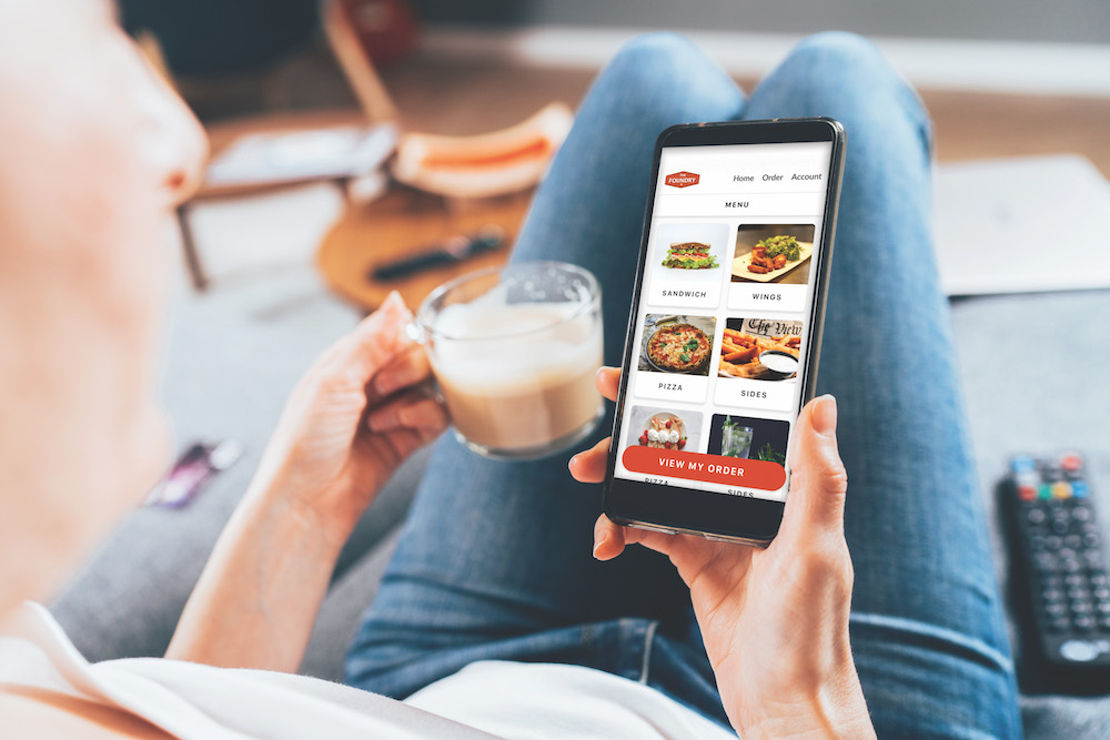 Person ordering food in mobile app for delivery