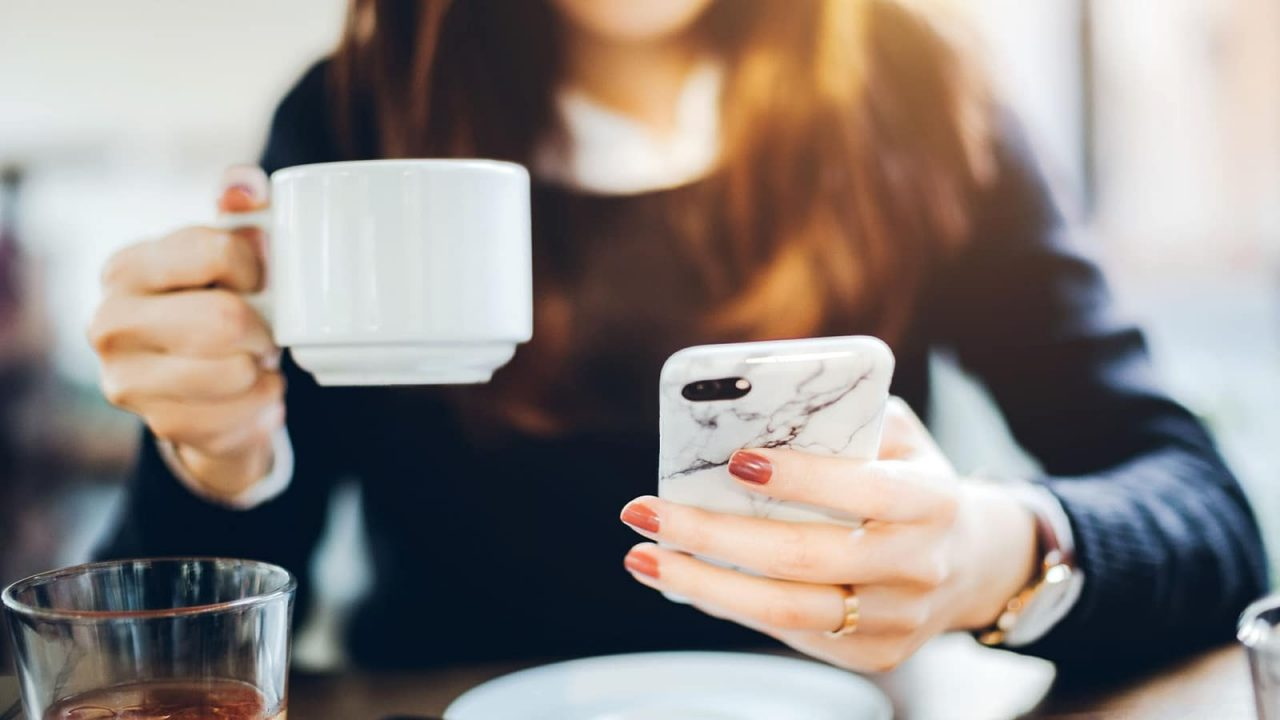 girl with phone and coffee