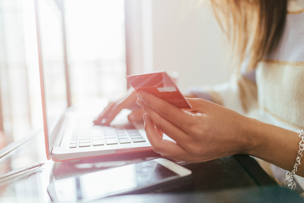 Female woman girl online shopping with her laptop and her credit card and mobile phone with her