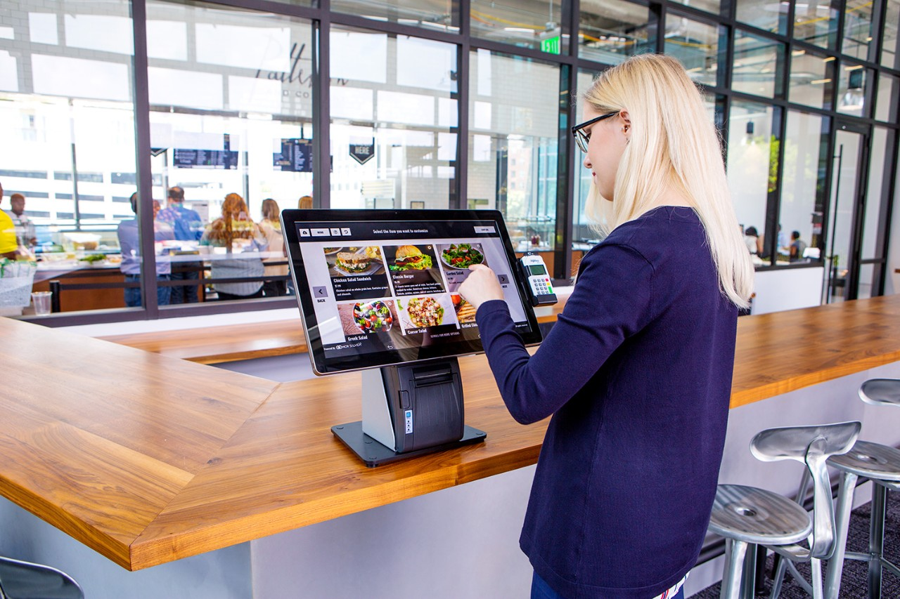 Female woman girl using countertop pos system for restaurant ordering