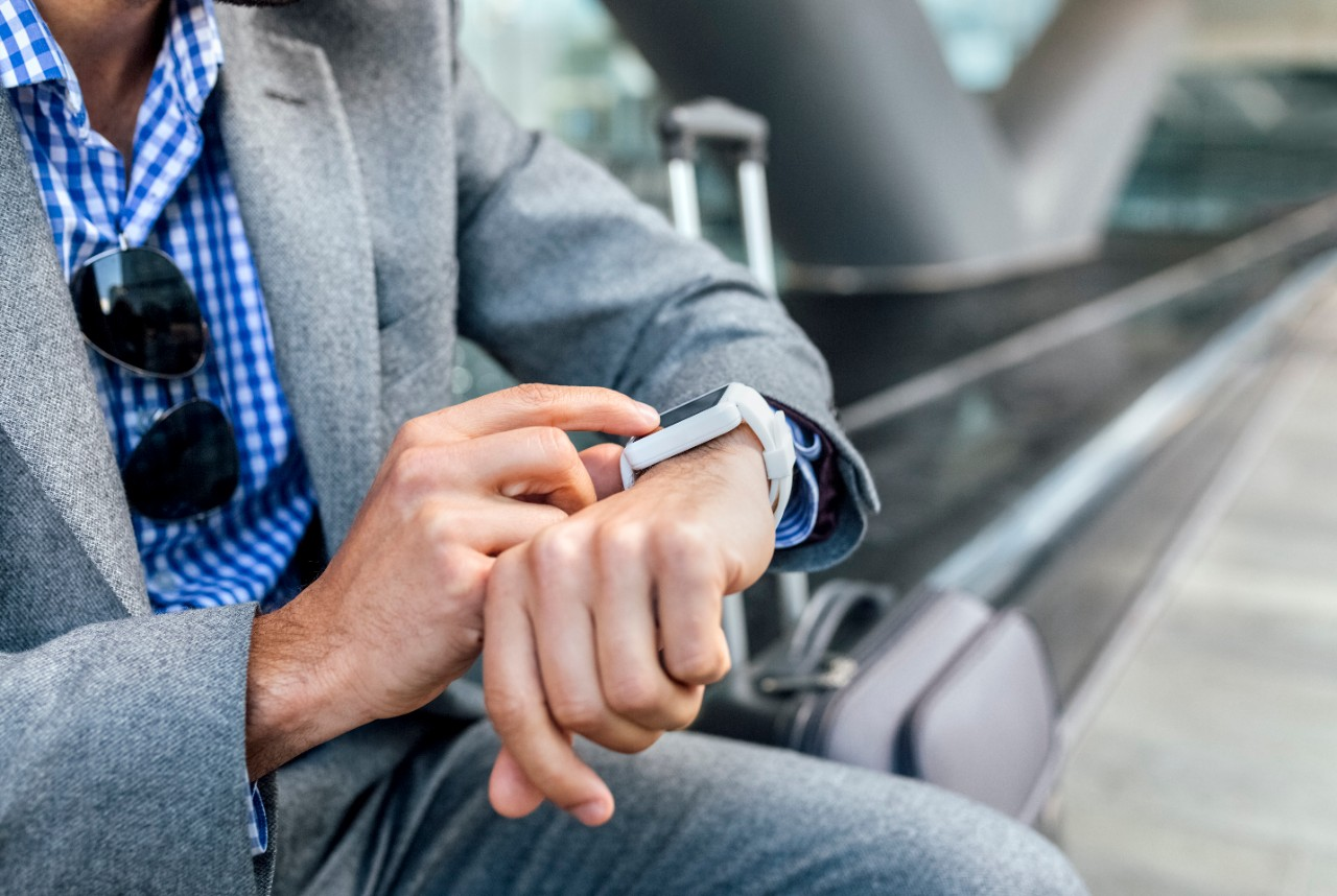Male man professional using smart watch outside