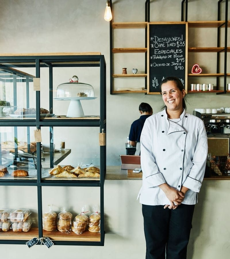 Woman in a bakery standing in front of the counter