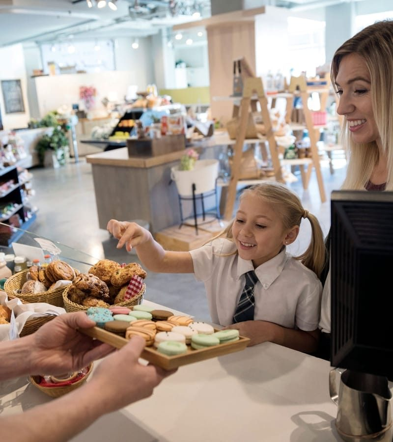 Woman and child getting items at a bakery
